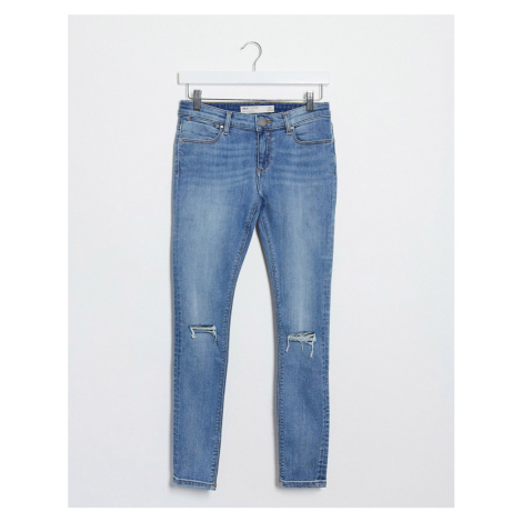 ASOS DESIGN whitby low waist 'skinny' Jeans in lightwash blue with rips