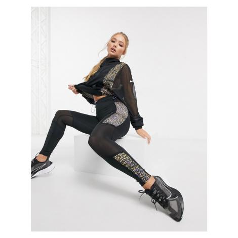 Nike Running Fast cropped leggings in black and orange