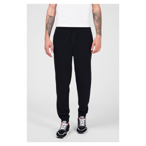 Tommy Jeans pánské černé tepláky Tommy Hilfiger