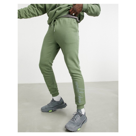 ASOS Dark Future co-ord oversized jogger with logo print in olivine-Green