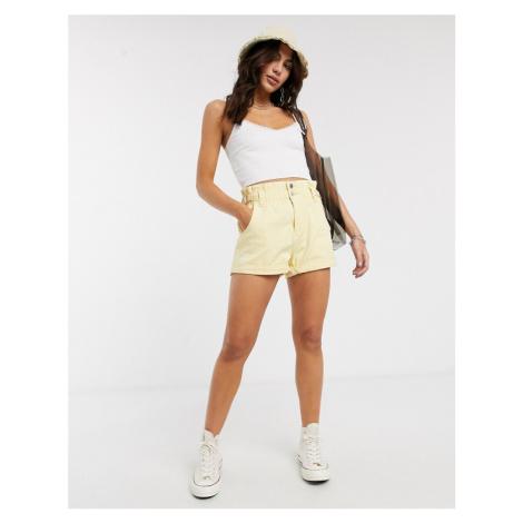 Bershka high rise elasticated waist shorts with roll hem in yellow