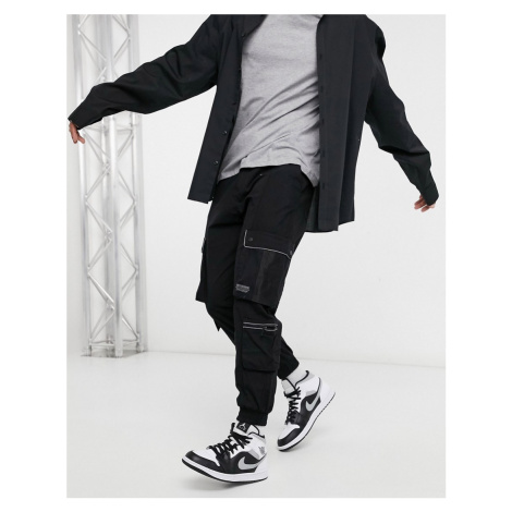 Bershka utility cargo trousers in black with reflective piping