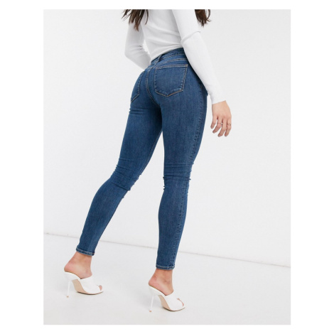 ASOS DESIGN whitby low waist 'skinny' Jeans in lightwash blue