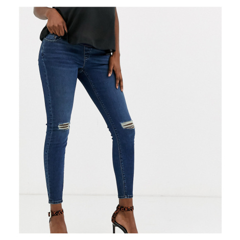 ASOS DESIGN Maternity high rise ridley 'skinny' jeans in dark stonewash blue with busted knee wi
