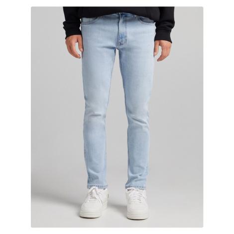Bershka slim jeans in mid blue