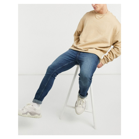 ASOS DESIGN skinny jeans in dark greencast wash-Blue