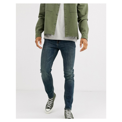 ASOS DESIGN skinny jeans in vintage dark wash-Blue