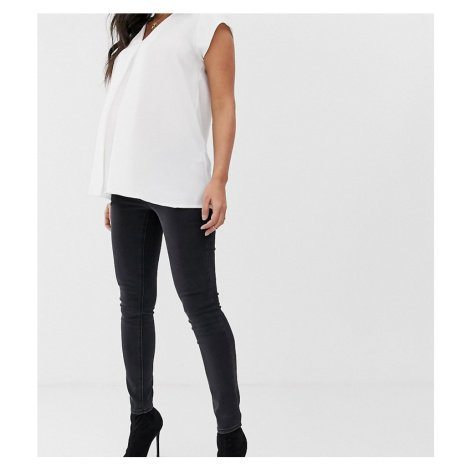 ASOS DESIGN Maternity Ridley high waisted skinny jeans in washed black with under the bump waist
