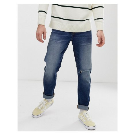 ASOS DESIGN slim jeans in dark wash blue with busted knee rip
