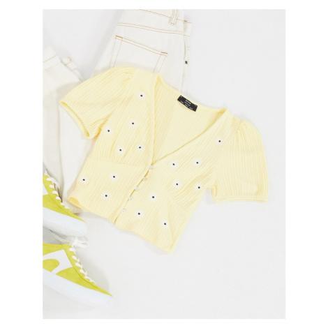 Bershka button down cropped daisy print t-shirt in yellow