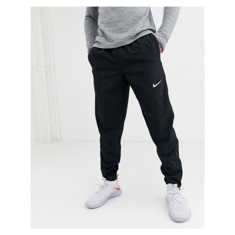 Nike Running woven joggers in black
