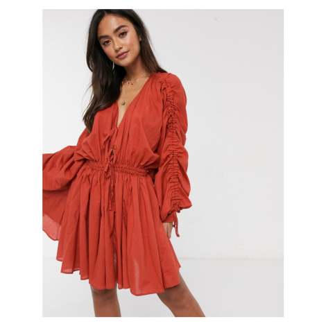 ASOS DESIGN cotton tiered mini dress with drawstring details in rust