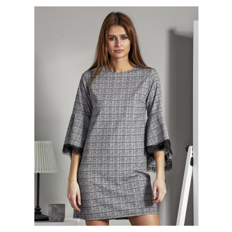 Black and white dress with a pattern and decorative sleeves Fashionhunters