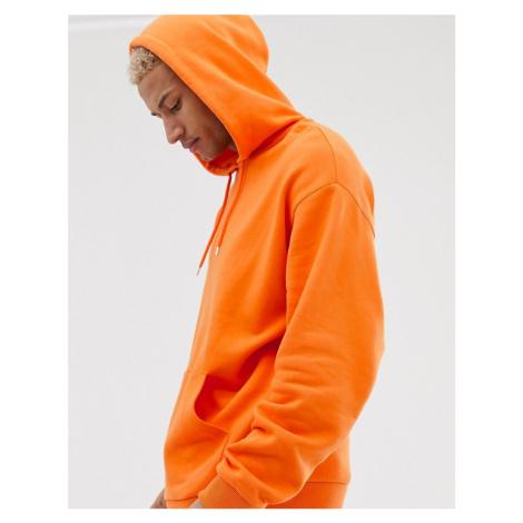 ASOS DESIGN oversized hoodie in orange