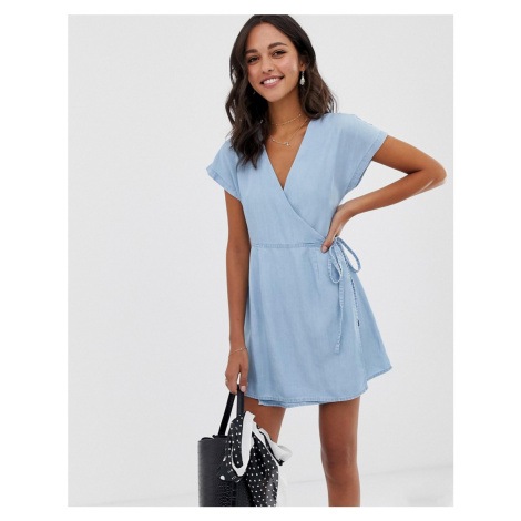 ASOS DESIGN denim wrap dress in lightwash blue