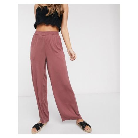 Vero Moda satin wide leg trousers in pink