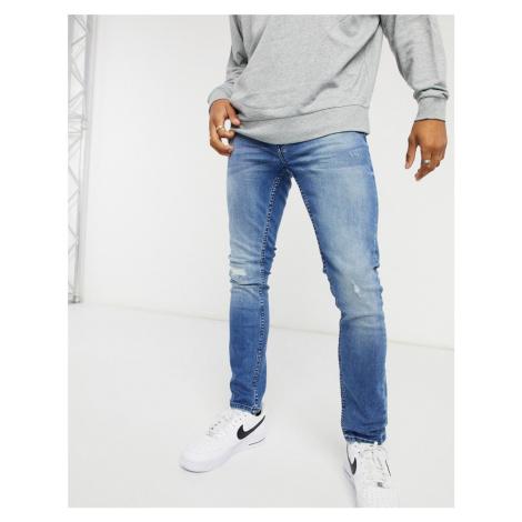Burton Menswear skinny blow out jeans in blue