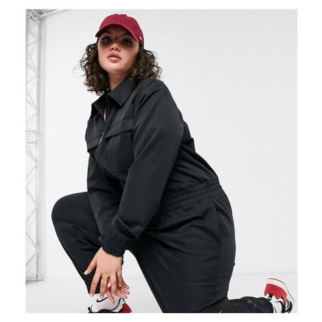 Nike Swoosh Plus utility jumpsuit in black