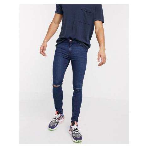 ASOS DESIGN spray on jeans in power stretch denim in dark wash blue with knee rips