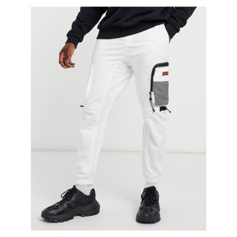 Bershka multi pocket cargo joggers in white