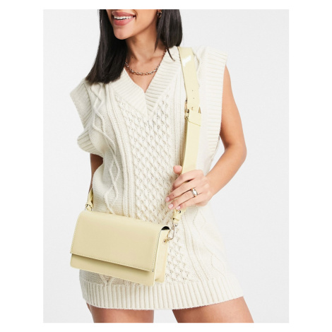 ASOS DESIGN elongated crossbody bag in buttermilk patent-White