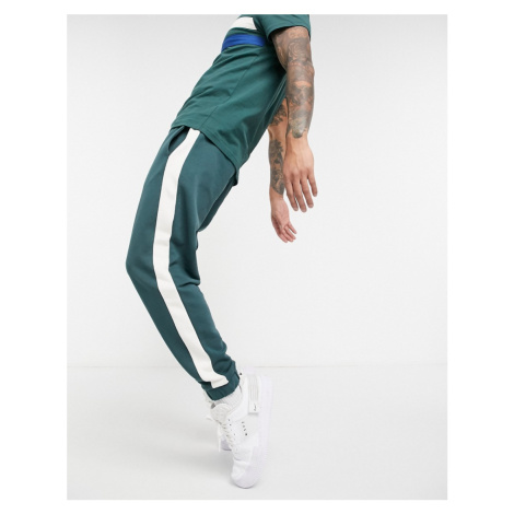 ASOS DESIGN co-ord tapered joggers with side stripe in deep green