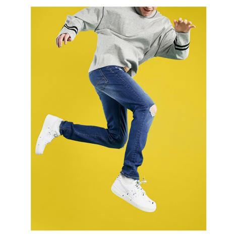 ASOS DESIGN skinny ripped jeans in dark wash blue