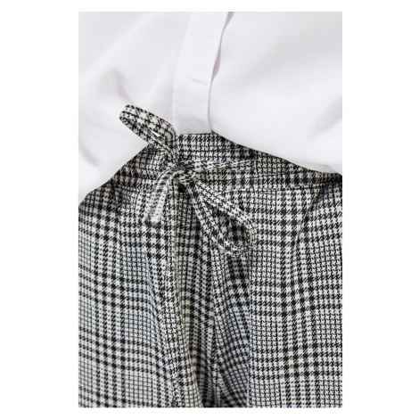 Knitted trousers with a tie Moodo