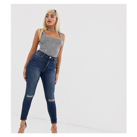 ASOS DESIGN Petite Ridley high waisted skinny jeans in dark stonewash blue with busted knee