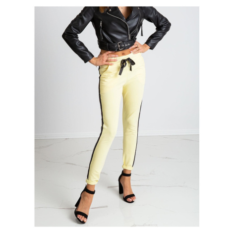 Light yellow sweatpants with a stripe Fashionhunters