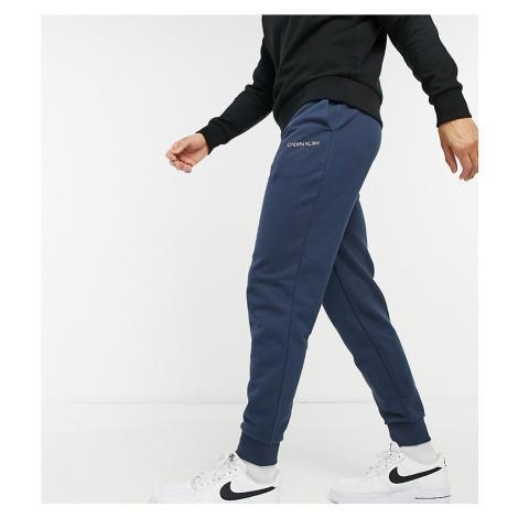 Calvin Klein exclusive to Asos reversed logo cuffed joggers in dark ocean-Blue