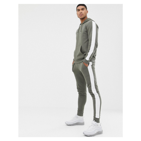 ASOS DESIGN tracksuit hoodie/skinny joggers with side stripe in khaki-Green