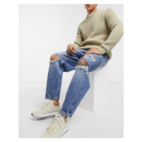 Bershka loose fit jeans with rips in mid blue wash