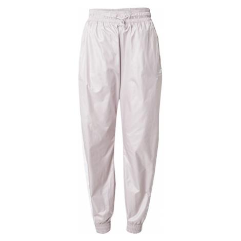 New balance Sportovní kalhoty 'Athletics Woven' lenvandulová / bílá