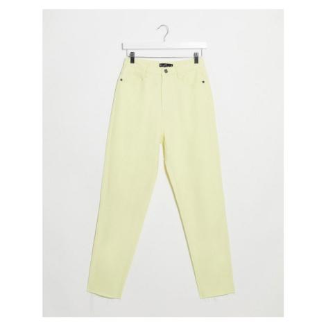 Missguided raw hem mom jean in lemon-Yellow