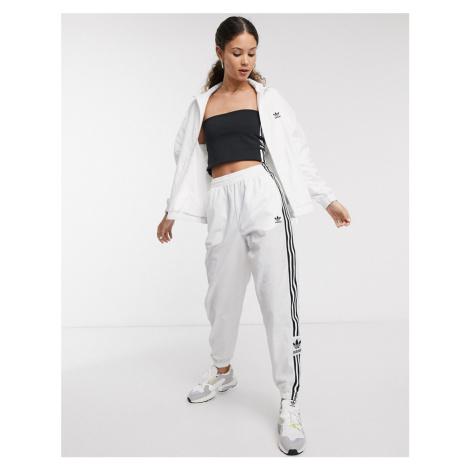 Adidas Originals adicolor locked up logo track pants in white