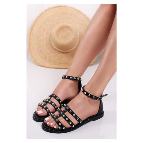 Černé vybíjené nízké sandály Inga Bestelle