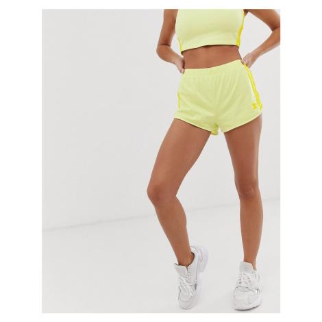 Adidas Originals adicolor three stripe shorts in neon yellow