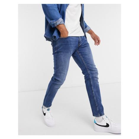 Bershka skinny fit jeans in mid blue