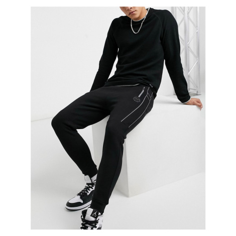 Bershka pique joggers with reflective piping in black