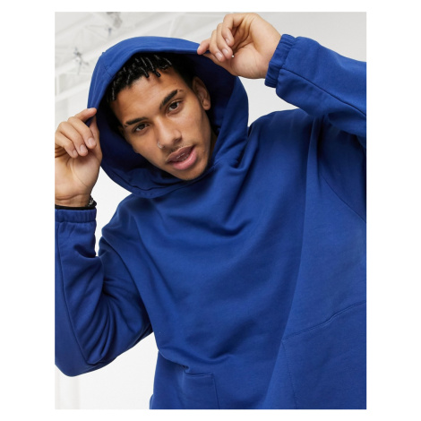 ASOS DESIGN oversized hoodie with square pockets in dark blue