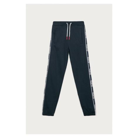 Guess - Dětské kalhoty 128-175 cm