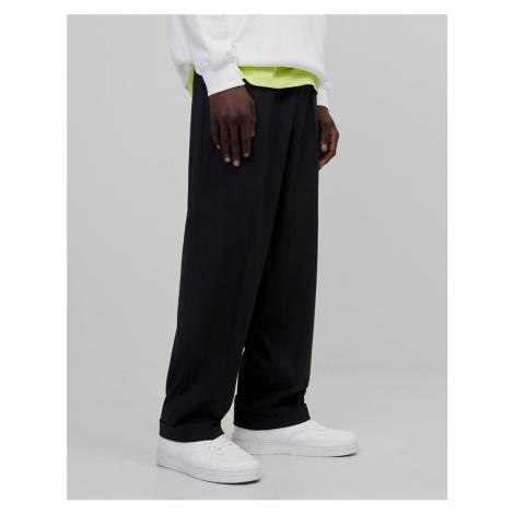 Bershka wide leg trousers in black