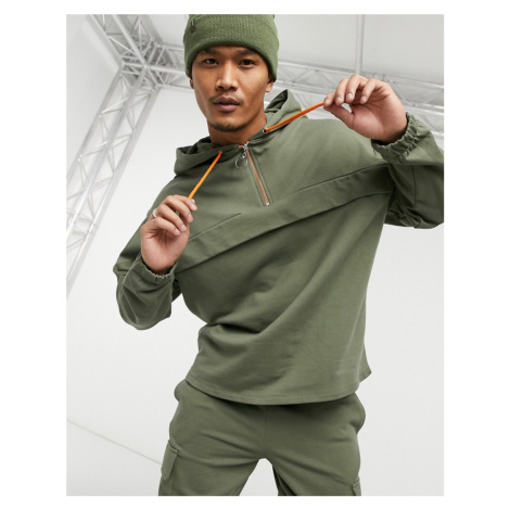 ASOS DESIGN co-ord oversized hoodie in washed green with orange tech details
