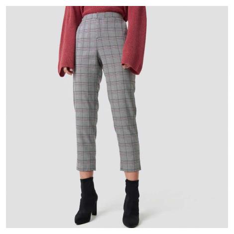 Šedé kostkované kalhoty Dilara × NA-KD