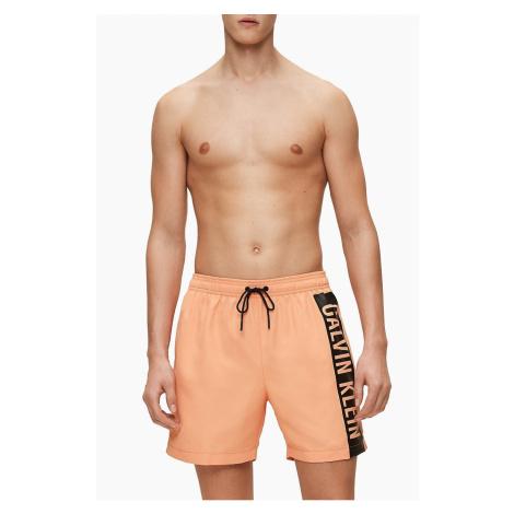 Calvin Klein oranžové pánské plavky Medium Drawstring s logem