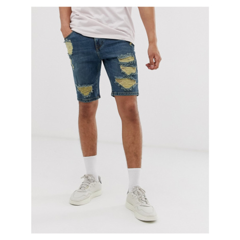 ASOS DESIGN denim shorts in skinny dark wash blue with heavy rips