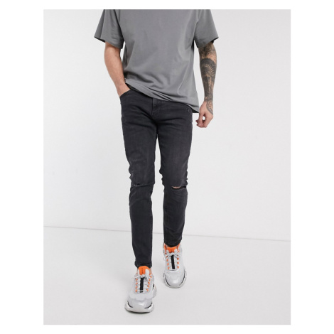 Bershka skinny jeans with knee rips and abrasions in black