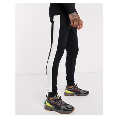ASOS DESIGN organic skinny joggers with side stripe in black