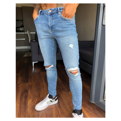 ASOS DESIGN spray on'vintage look' jeans with power stretch in mid wash blue with knee rips
